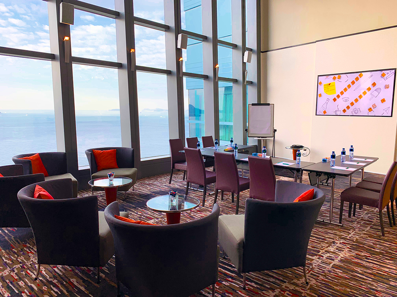 business lounge area with the harbour view of hong kong
