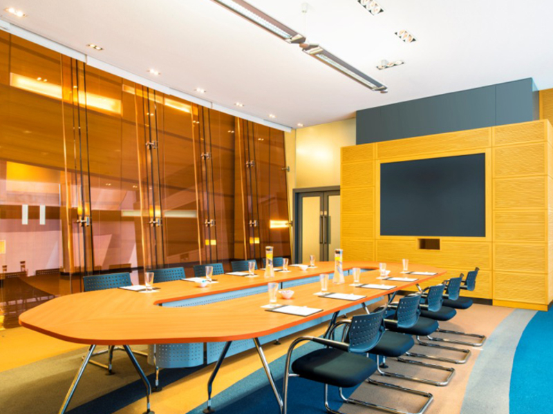 private meeting room using conference style seating equipped with carpets and audio visual system