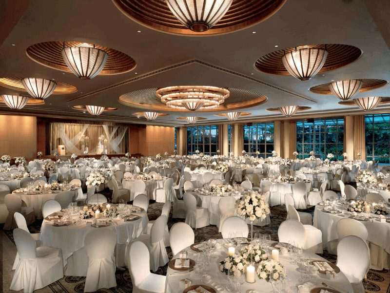 white ballroom with floral arrangements