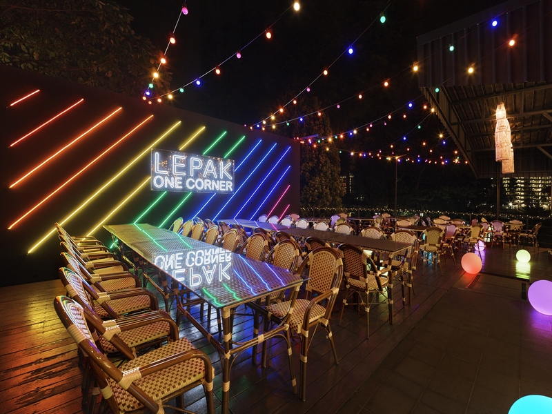 alfresco area with colourful hanging lights and big led screen
