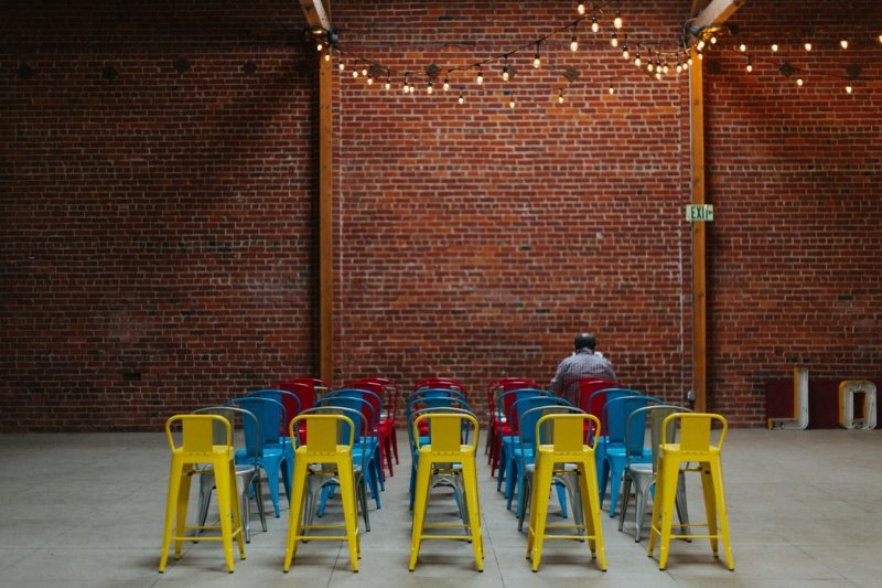 colourful audience chairs and brick walls in singapore event venue
