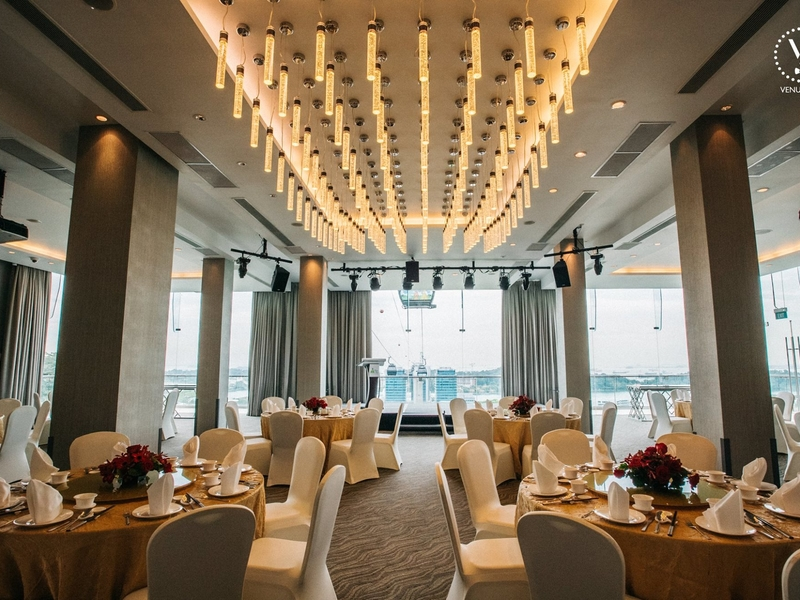 singapore ballroom with large glass wall and yellow pendant lamps