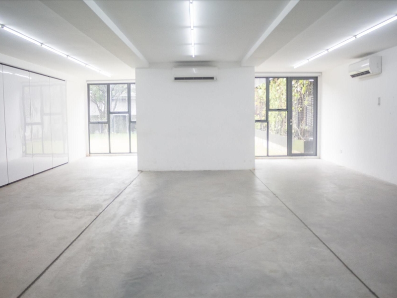 large black and white space in singapore with big windows