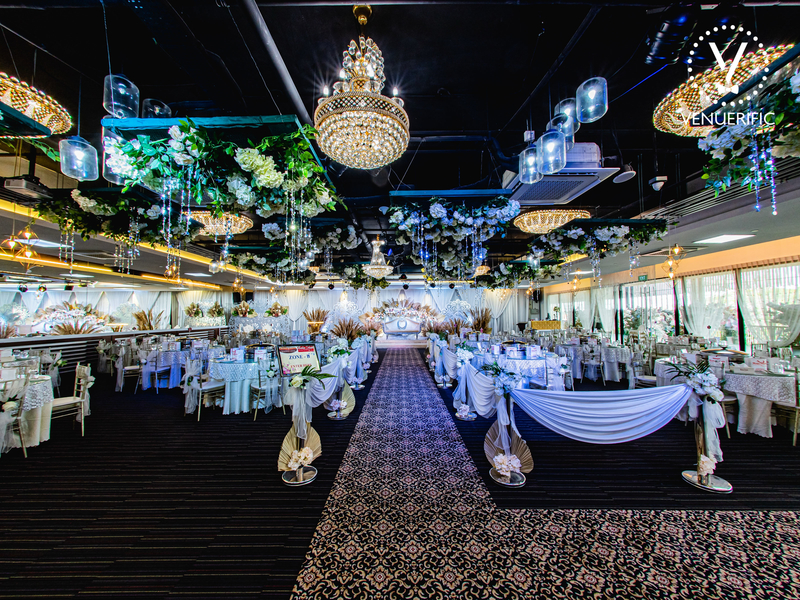Beautiful function hall with chandeliers and tables