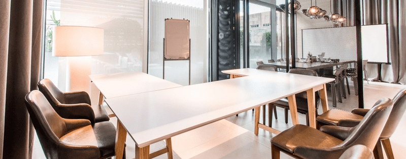 u-shaped meeting room in singapore with room divider and big windows