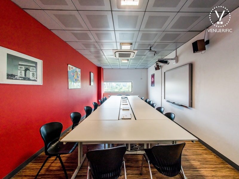 small private meeting room in singapore with white board and red wall