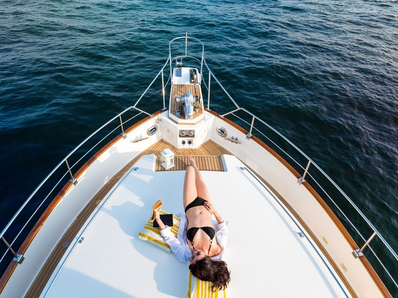 woman sunbathing in singapore party yacht