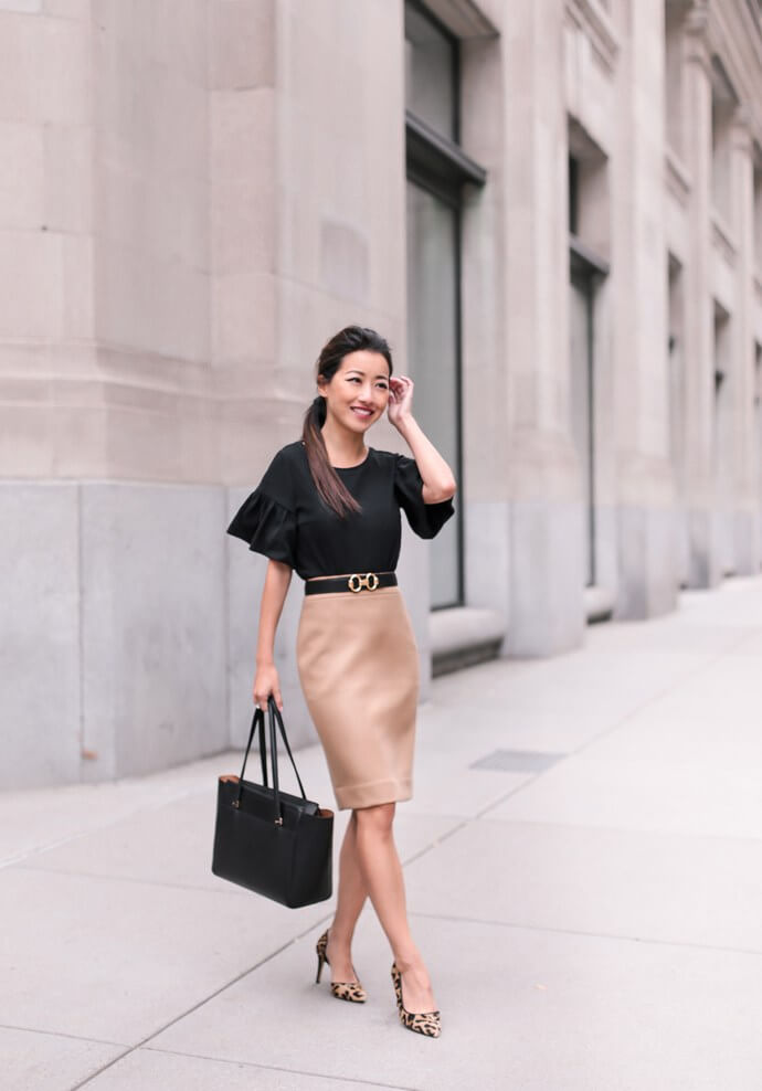 lady wearing black top and pink skirt