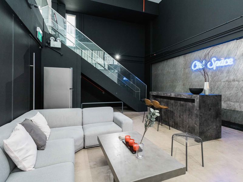 black and white venue in singapore with stairs and long couches