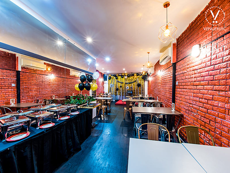 bricks wall and black buffet tables in singapore small wedding space