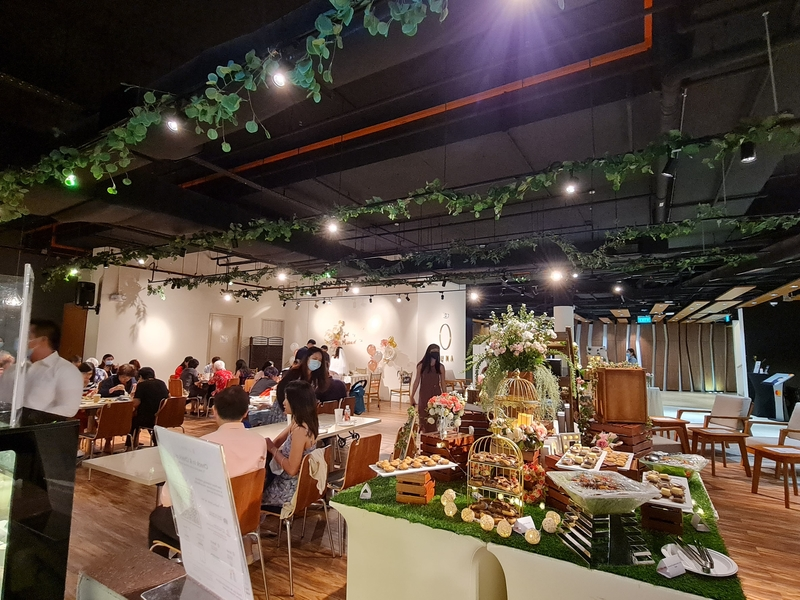 Wedding space with nature decorations and people