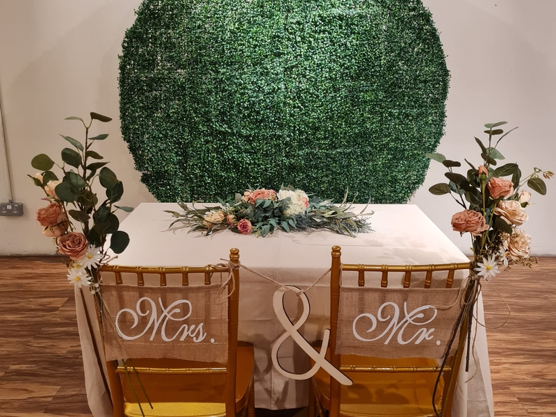 Mrs & Mr chairs and white table with floral decoration