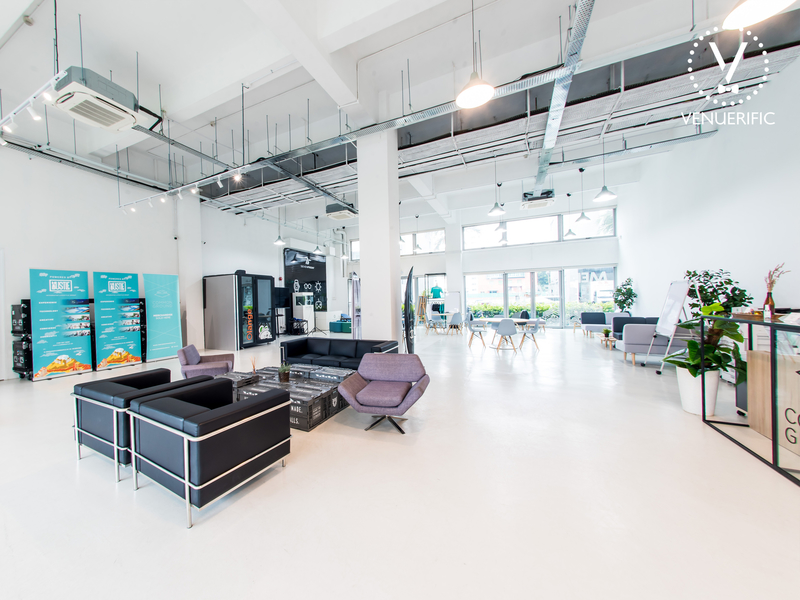 Wide unique space with white walls and floors
