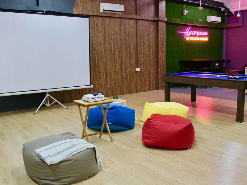 Projector screen with bean bags and pool table