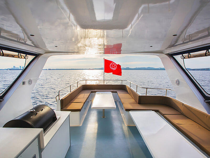 A boat's outdoor lounge area, riding in the sea