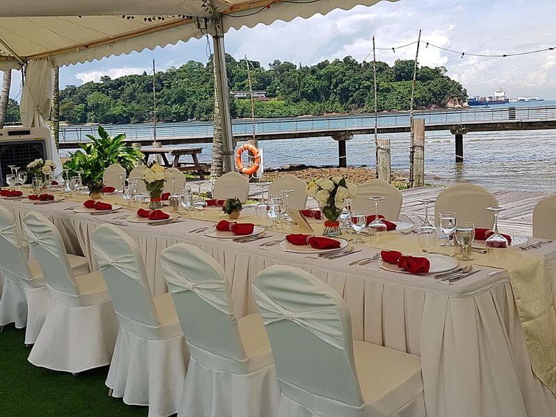 intimate wedding venue in singapore with sea view and white decoration