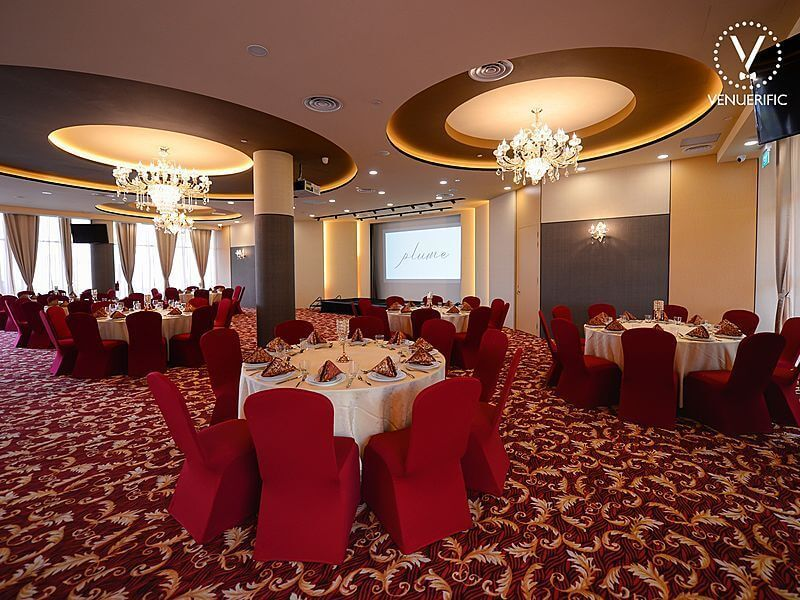 red theme wedding venue with pillars and crystal lights