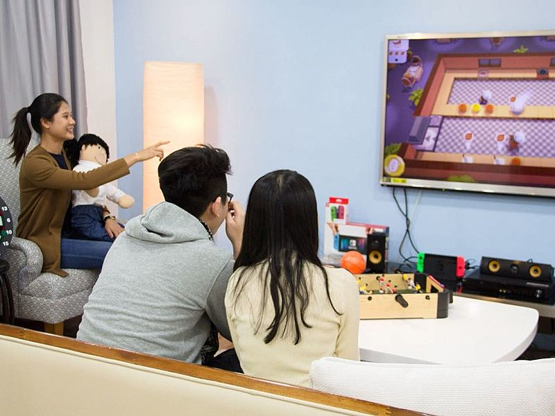 family playing a game of overcooked on switch