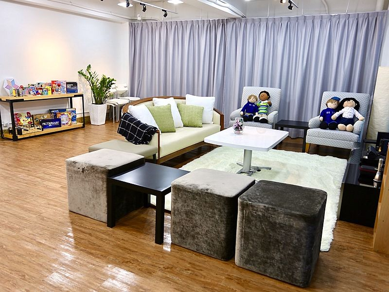 spacious room with board games and sofa