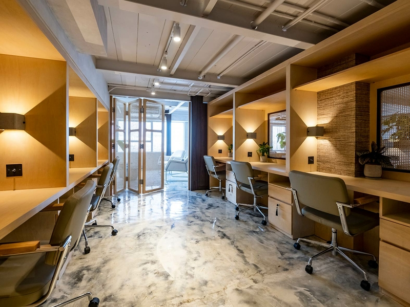 private space with tables and chairs for coworking
