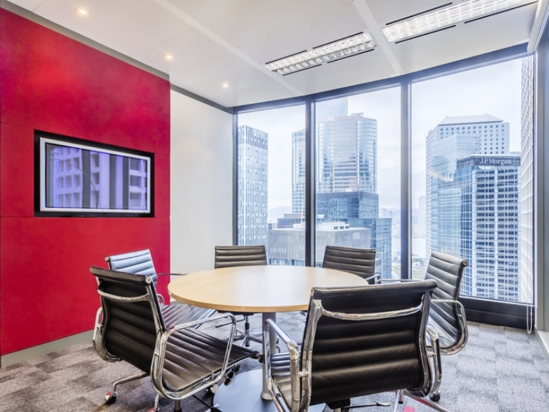 Professionally furnished meeting room with view of the city