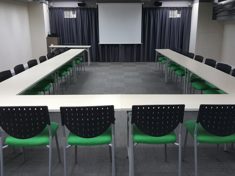 green chairs arranged for a board meeting