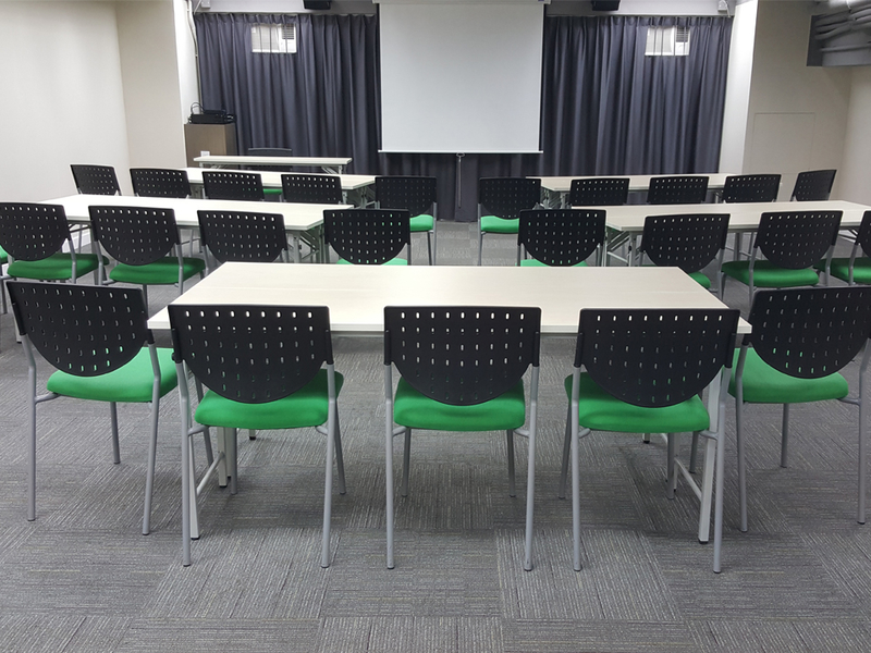 green chairs in a spacious room for meeting