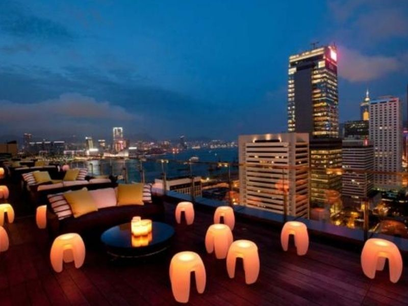 Rooftop lounge area with seats and lights