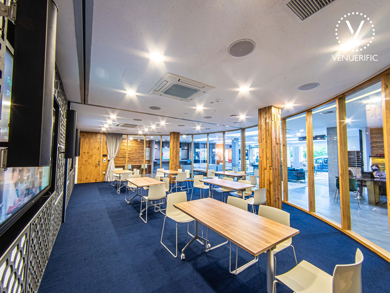 Indoor meeting room with tables and chairs