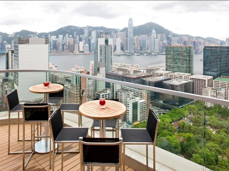 outdoors seating area with view of the city