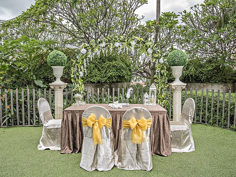 outdoor wedding reception set up with tables and chairs