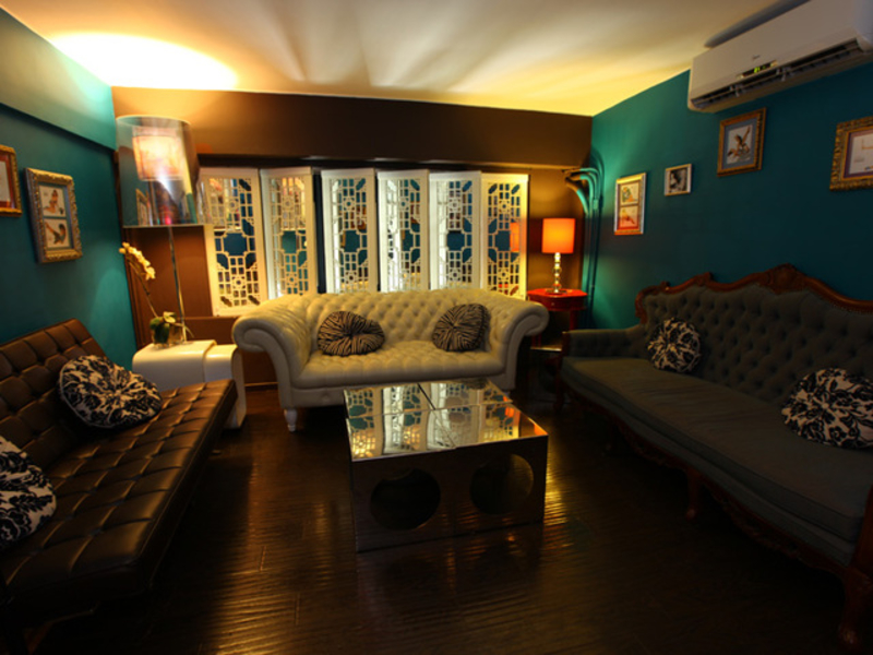 vintage sofas in a multi coloured room