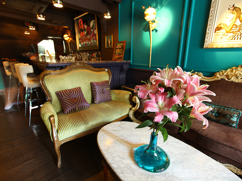 sofas in a bar and flowers on a coffee table