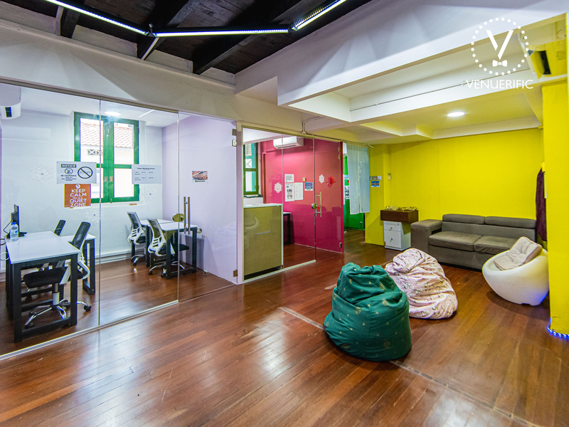 Bright corporate event space with bean bags, sofas and rooms to work in