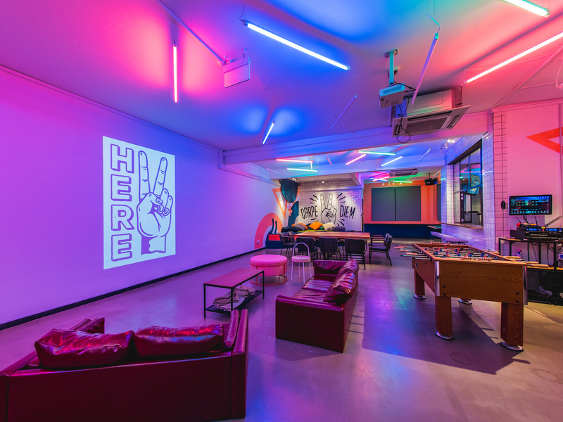LED Lit room with foosball table, sofas,