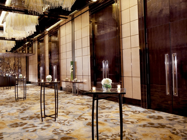 Hallway with chandeliers and tall squared tables, perfect solemnisation venue in Hong Kong