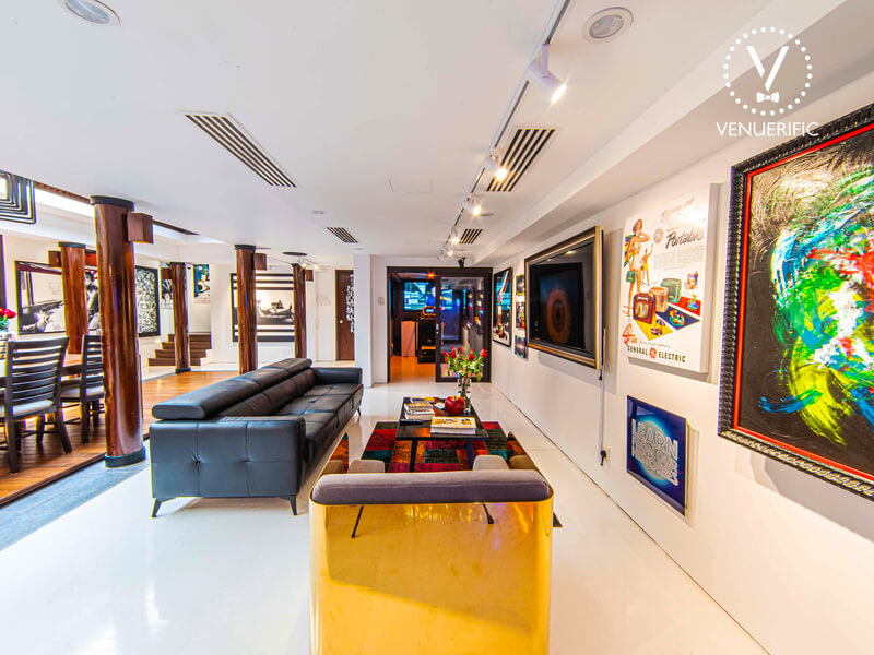 space with sofas and colourful art pieces