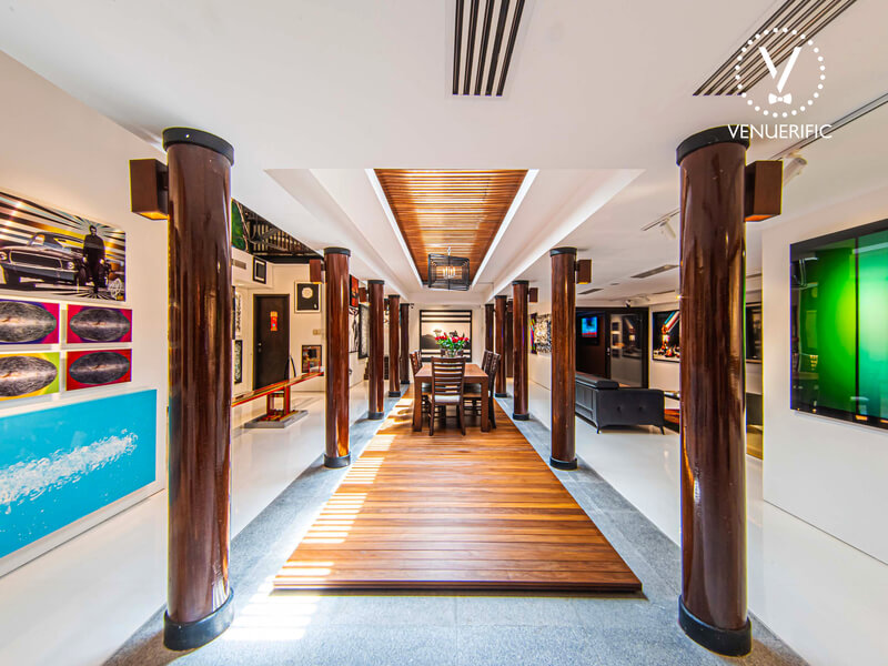 venue with art pieces and dining area in the middle