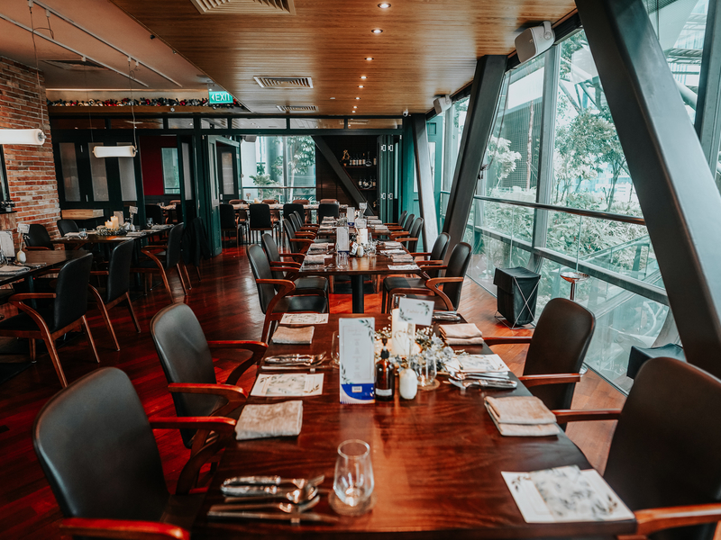 restaurant with wooden table and black chairs