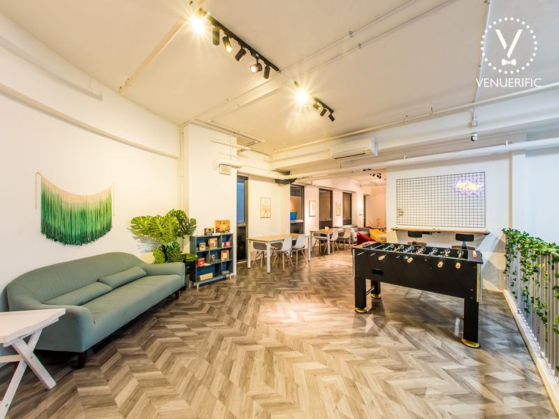 loft with soccer table and sofa