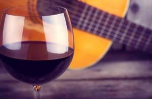 guitar and Wine on a wooden table