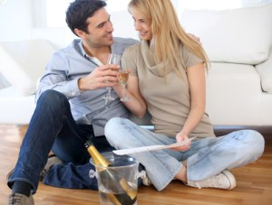 Couple celebrating for the purchase of new home