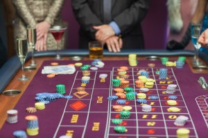 People standing at the table looking at the table at the casino