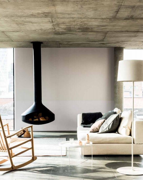 Suspended woodstove from rustic concrete ceiling