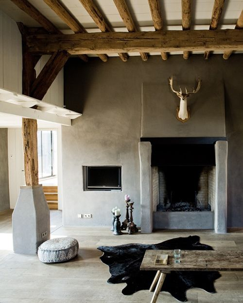 A little deer over the fireplace and look at how clever the TV has been recessed into the wall - via The Decorista