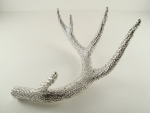 Antlers covered in Swarovski rhinestones, great if you like ott - via Etsy
