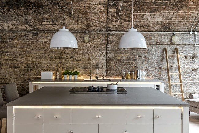 Beautiful kitchen by Neptune in an old industrial building, I like the hidden stringlights, the  doorknobs and of course the spectacular old brick walls - via The Paper Mulberry