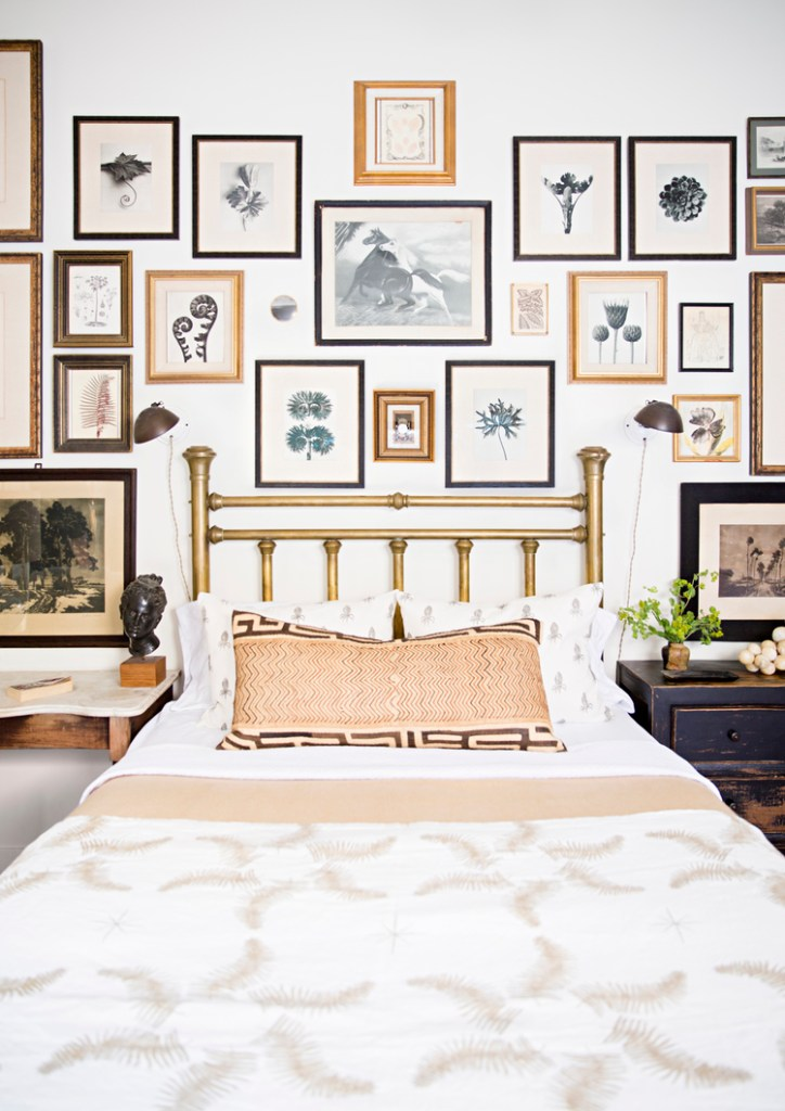 Color-coordinated gallery wall in this eclectic bedroom - via Brittany Ambridge Photography