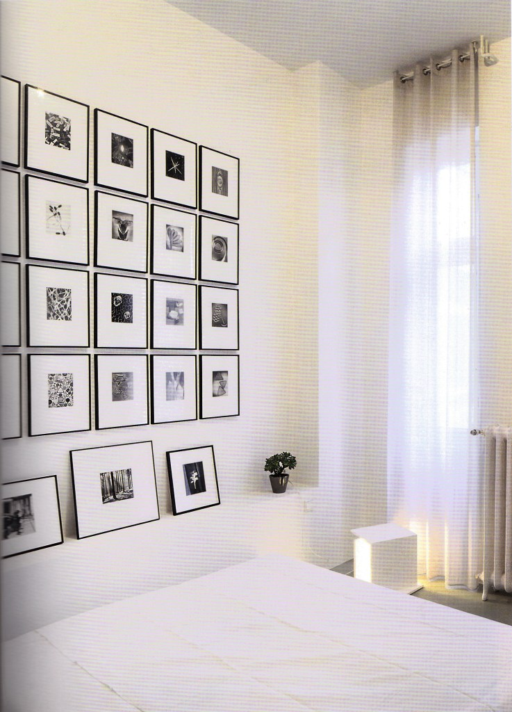 Gallery wall over the bed of Berlin art consultant Peter Heimer