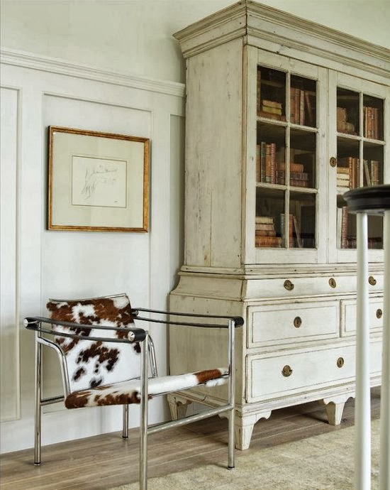 The iconic Wassily chair by Marcel Breuer next to an antique armoire - via Dustjacket